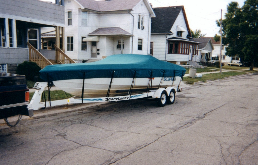Custom Sunbrella Boat Cover: Scarab mooring cover with adjustable trailering straps